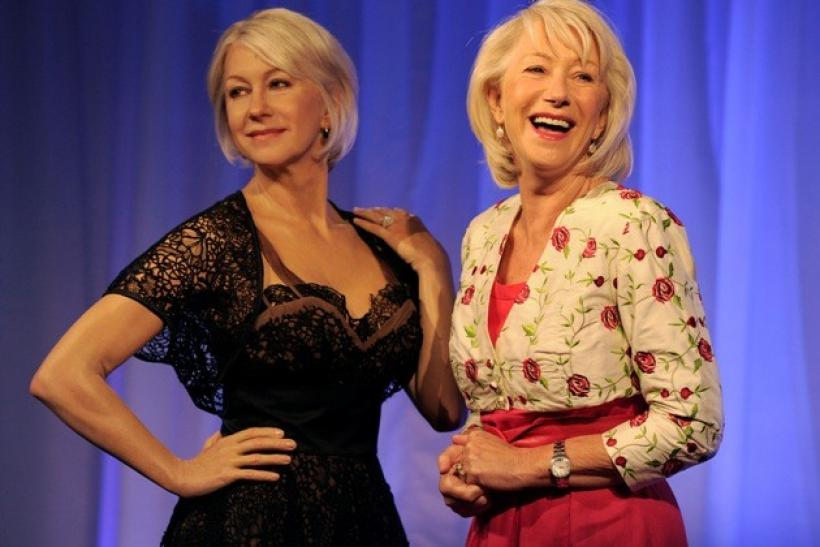 British actress Helen Mirren poses for photographers next to her wax model at Madame Tussauds in London