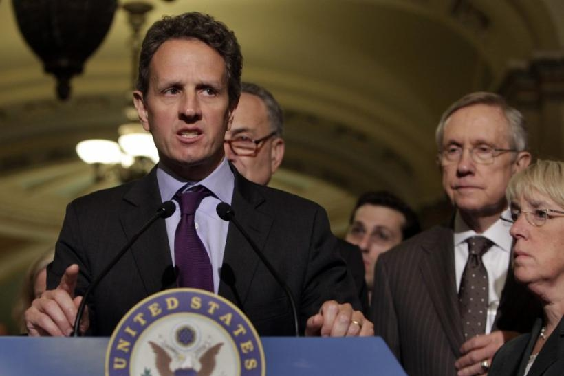 Timothy Geithner speaks to the media next to Harry Reid after his meeting about the debt limit on Capitol Hill in Washington