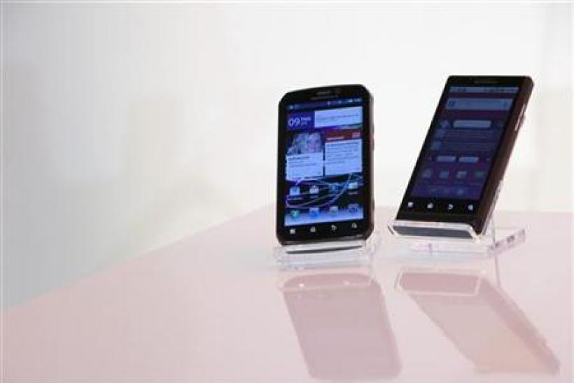 The Motorola PHOTON 4G Summer and the Motorola TRIUMPH Virgin Mobile Summer mobile phones are seen in New York