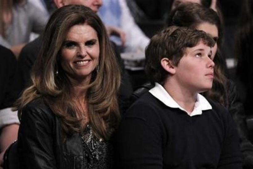 Maria Shriver (L) and son Christopher Schwarzenegger (R) attend the NBA basketball All-Star weekend in Los Angeles