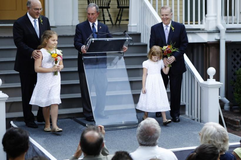New York City Mayor Michael Bloomberg (C) presides over the wedding of Jonathan Mintz (L), New York City's consumer affairs commissioner, and John Feinblatt (R), a chief adviser to the mayor, as they stand with daughters Maeve (L) and Georgia at Gracie Ma