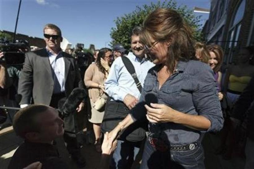 Former Alaska governor Sarah Palin greets supporters as she arrives for the premiere of a documentary about her entitled ''The Undefeated'' in Pella, Iowa