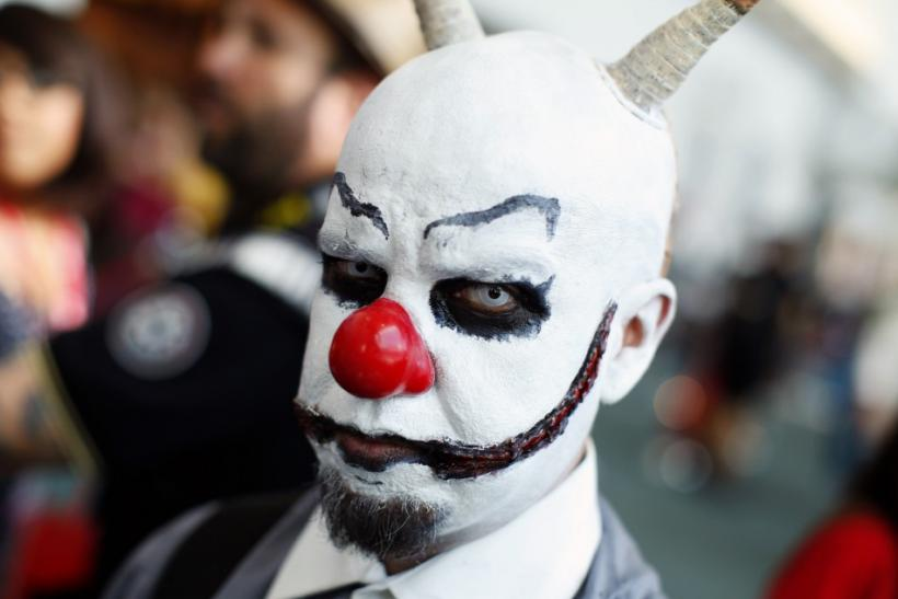 An attendee dressed in costume walks the Comic Con convention floor during the pop culture event in San Diego