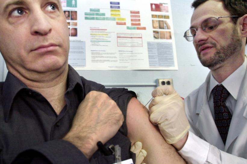 Dr. Stephen Friedman (R) vaccinates his colleague Dr. Don Weiss