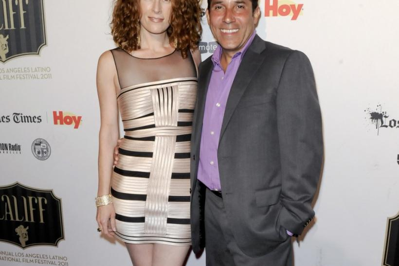 "Actor Oscar Nunez (R) and his wife Carla arrive at the 2011 Los Angeles Latino International Film Festival special screening of ""Without Men"" during the Maya Indie film series in the Hollywood area of Los Angeles, California"