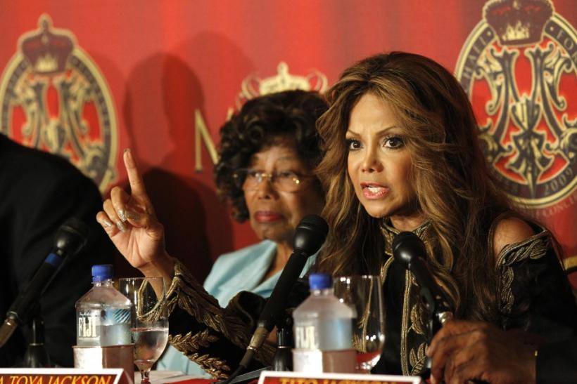 La Toya Jackson speaks, as her mother Katherine listens, at a news conference to announce a tribute concert for the 40th anniversary of the late pop star Michael Jackson's career in Beverly Hills, California