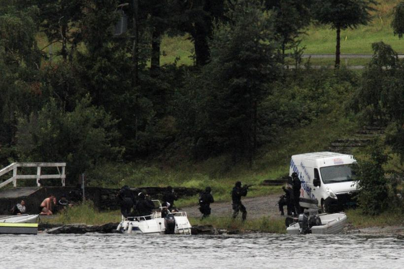 Members of Norwegian Special Forces land by boat on the shore of the island of Utoeya
