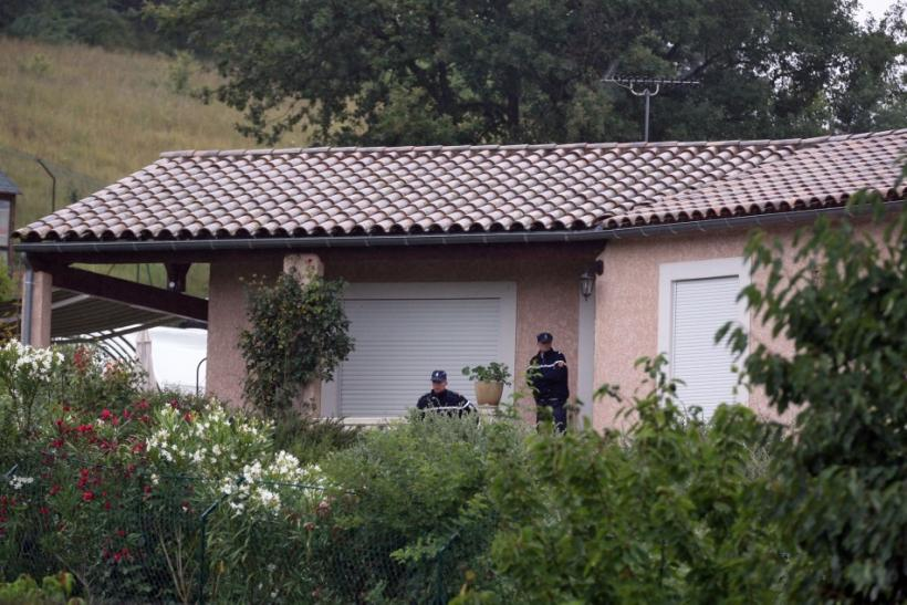 French gendarmes stand in front of the house of Jens Breivik, the father of Anders Behring Breivik in Cournanel
