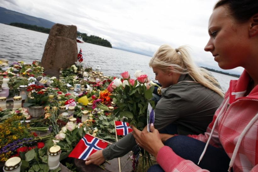 Women lay Norwegian flags