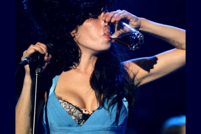 British singer Amy Winehouse drinks as she performs at the St. Lucia Jazz Festival in St. Lucia in this May 8, 2009 file photo