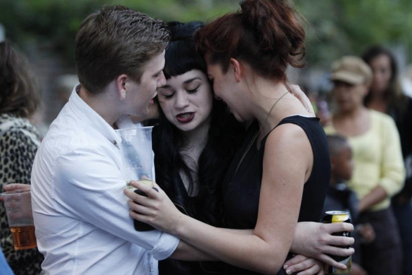 Fans embrace outside the house of British singer Amy Winehouse, following her funeral earlier in the day, in north London July 26, 2011. The funeral of British singer Amy Winehouse was held on Tuesday after an autopsy failed to pinpoint the cause of her d