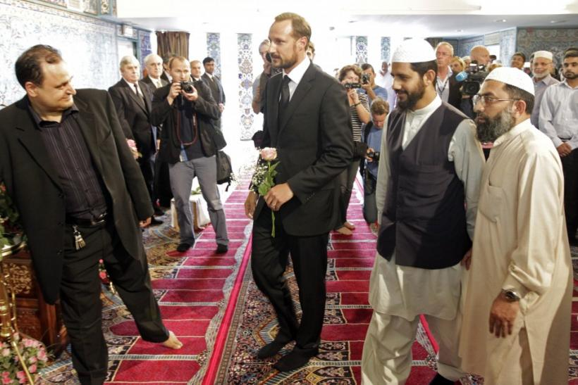 Norway's Crown Prince Haakon is welcomed inside the World Islamic Mission Mosque in Oslo