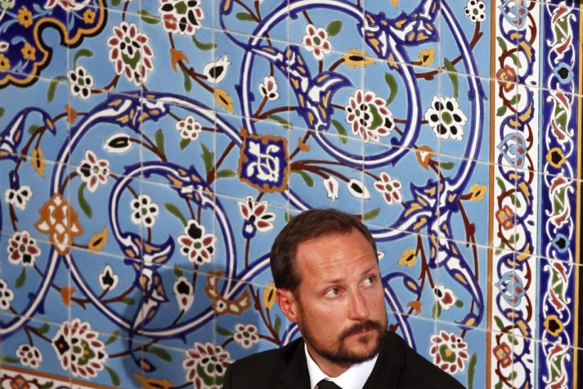 Norway's Crown Prince Haakon sits inside the World Islamic Mission Mosque in Oslo