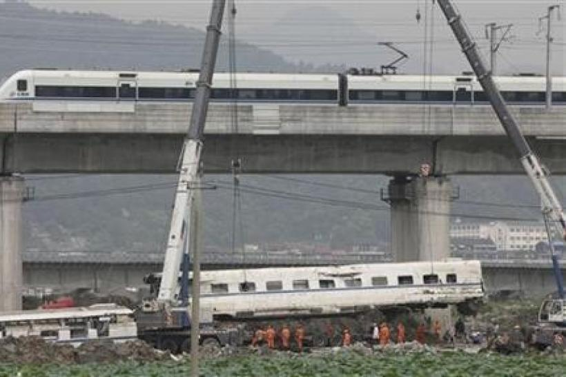 A high speed bullet train runs past a railway bridge