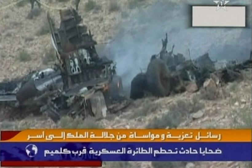 Still image from video shows smoke rising from the wreckage of a Hercules C-130 aircraft after it crashed while trying to land in Guelmim