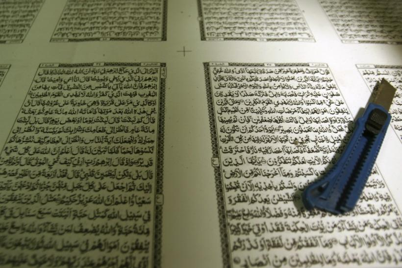 A paper cutter is placed on paper for the Koran at a printing press near the Sunan Ampel mosque in Surabaya, Indonesia East Java province