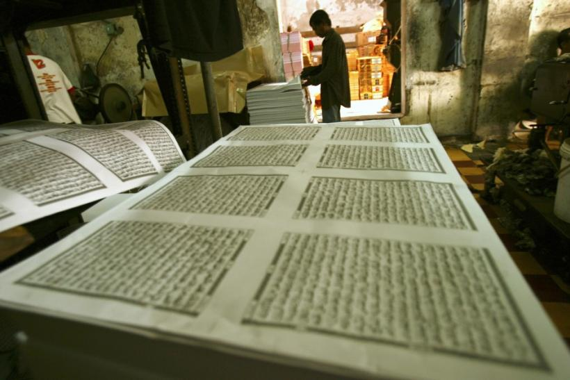 A worker looks checks printing paper for the Koran near the Sunan Ampel mosque in Surabaya, Indonesia East Java province