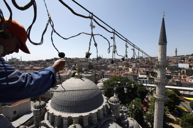 Mahya master Suleyman Kok takes part in the installation of Mahya at the top of one of the Yeni (New) mosque's minarets in Istanbul