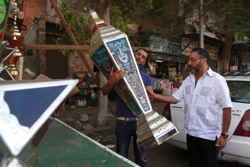 A man buys a big Ramadan lantern in a shop in Cairo ahead of the Muslim fasting month of Ramadan