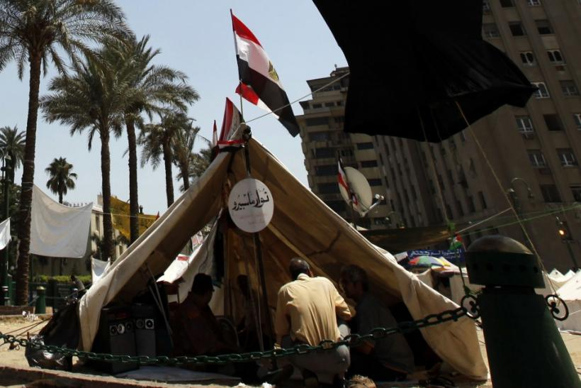 A huge traditional Ramadan lantern, modelled after the Egyptian flag, is seen at Tahrir square in Cairo