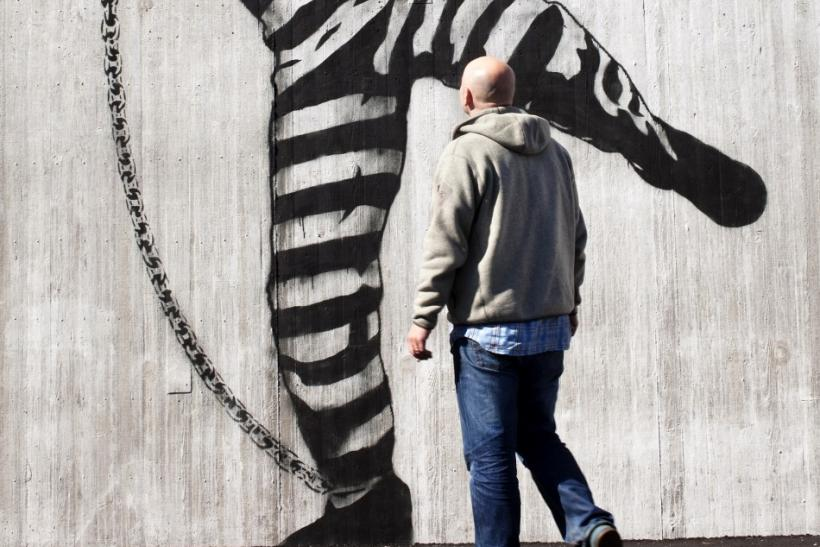 A man walks in front of graffiti inside Halden prison in the far southeast of Norway in this picture taken in 2010, released on July 27, 2011