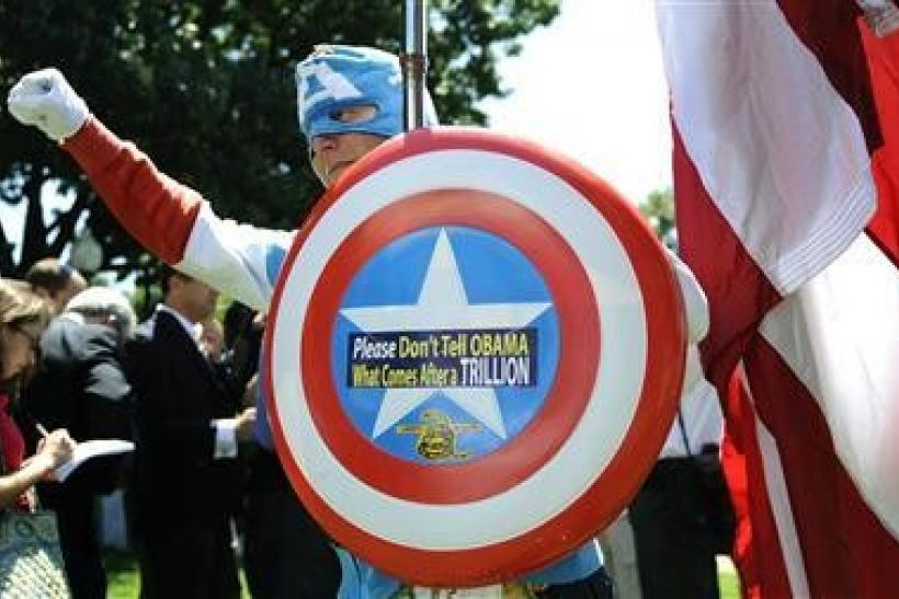 A Man dressed as Captain America poses as dozens of Tea Party supporters rally near the Capitol against raising the debt limit in Washington