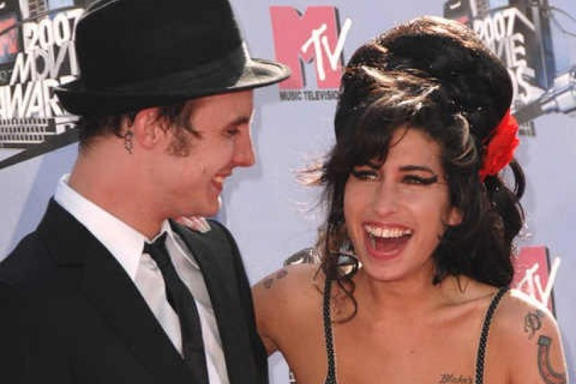 Singer Amy Winehouse and husband Blake Fielder-Civil attend the 2007 MTV Movie Awards in Los Angeles, California June 3, 2007.