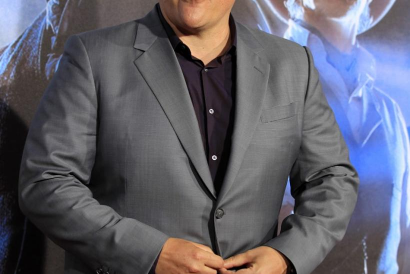 "Director Jon Favreau arrives for the world premiere of the movie ""Cowboys & Aliens in conjunction with Comic Con in San Diego"