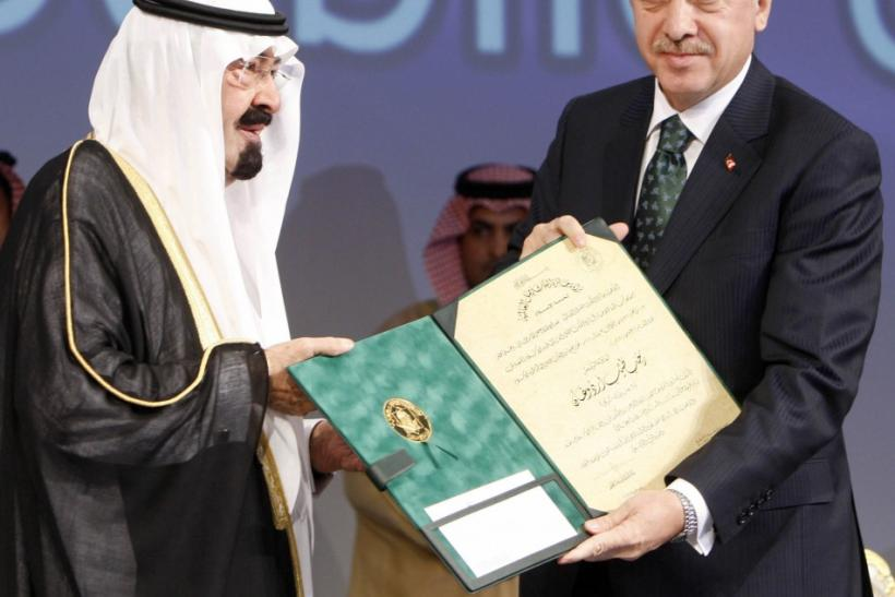"Turkey's Prime Minister Tayyip Erdogan receives the ""King Faisal International Prize"" from Saudi King Abdullah in Riyadh"