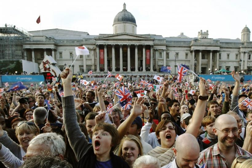 Spectators celebrate during the London 2012 Olympic Games one year countdown at an Olympic event in Trafalgar Square in London