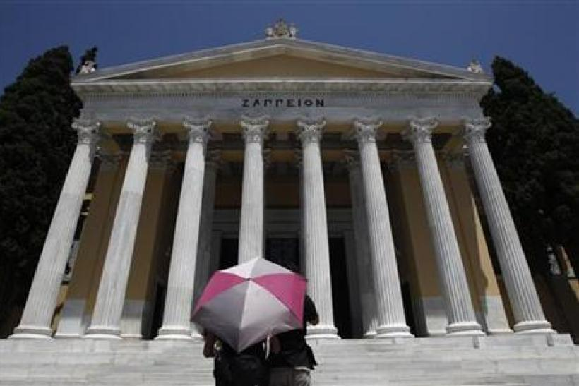 Tourists stand in front of Zappeion mansion in Athens