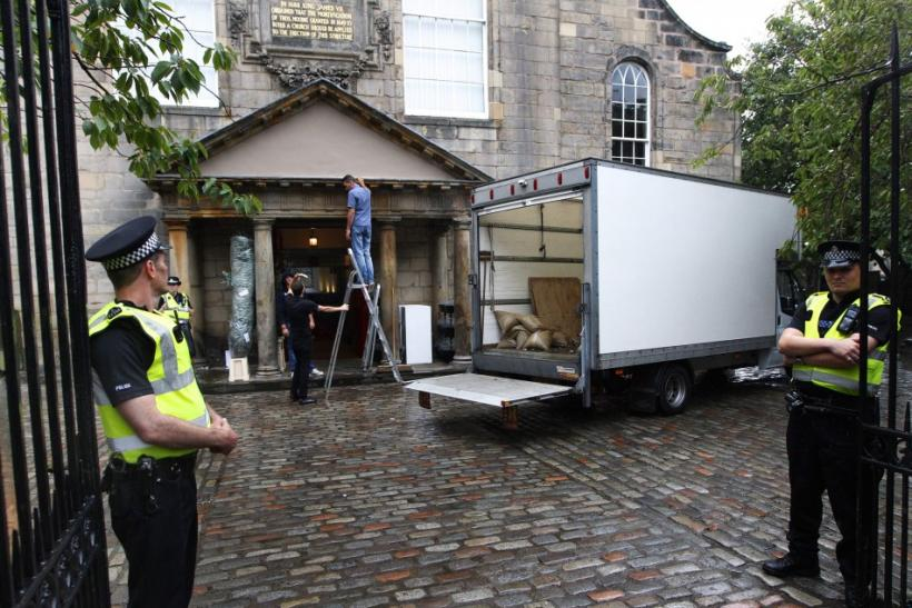 Police stand guard as preparations get underway for the wedding of Zara Phillips and Mike Tindall, at the entrance to the Canonngate Kirk in Edinburgh, Scotland July 28, 2011. The Queen's grandaughter Phillips will marry England rugby player Tindall at th