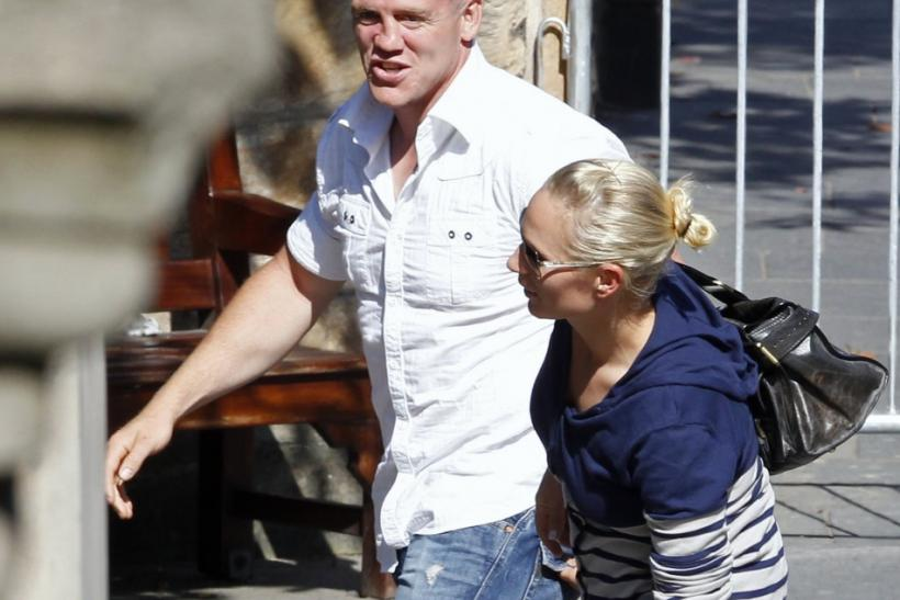 Britain's Zara Phillips, the eldest granddaughter of Queen Elizabeth, and England rugby captain Mike Tindall, arrive for their wedding rehearsal at Canongate Kirk in Edinburgh, Scotland