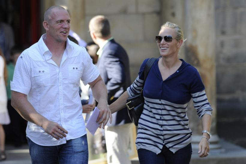 Britain's Zara Phillips, the eldest granddaughter of Queen Elizabeth, and England rugby captain Mike Tindall leave Canongate Kirk, following their wedding rehearsal, in Edinburgh, Scotland