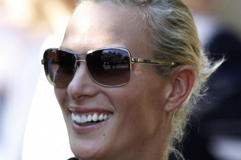 Zara Phillips smiles as she leaves her wedding rehearsal at the Canongate Kirk in Edinburgh, Scotland