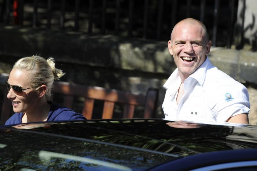 Britain's Zara Phillips (L), the eldest granddaughter of Queen Elizabeth and England rugby captain Mike Tindall (R), arrive for their wedding rehearsal, at Canongate Kirk in Edinburgh, Scotland