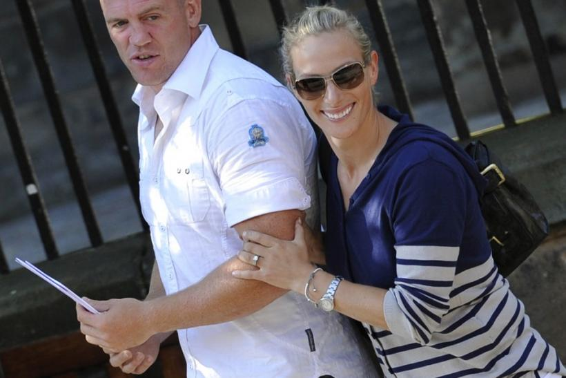 Britain's Zara Phillips and England rugby captain Mike Tindall leave after their wedding rehearsal at Canongate Kirk in Edinburgh