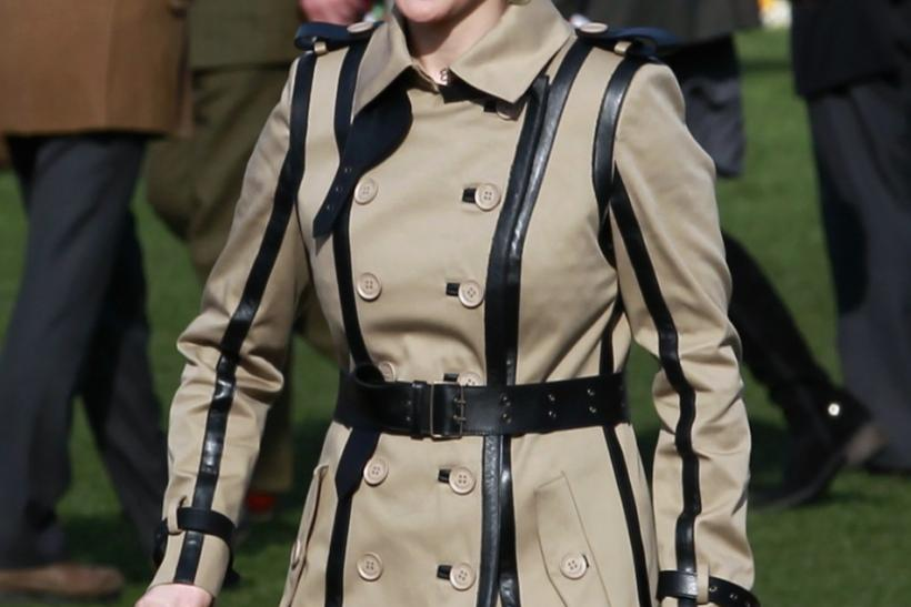 Britain's Zara Phillips smiles as she walks through the unsaddling enclosure during the Cheltenham Festival horse racing meet in Gloucestershire