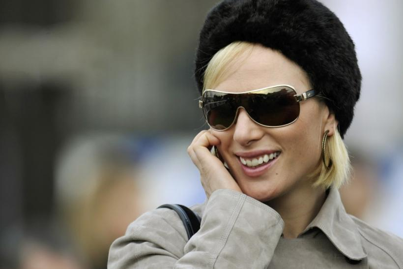 Britain's Zara Phillips smiles as she watches the races at the Cheltenham Festival horse racing meet in England