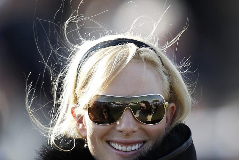 Zara Phillips smiles during The Cheltenham Festival in Gloucestershire