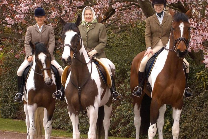 A picture showing Britain's Queen Elizabeth (C) with her daughter Princess Anne (R) and her granddaughter Zara Phillips riding at Windsor Castle during Easter, has been released by Buckingham Palace to mark the monarch's 78th birthday