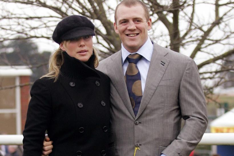 Britain's Zara Phillips (L), granddaughter of Queen Elizabeth, and boyfriend England rugby player Mike Tindall arrive on the first day of the Cheltenham National Hunt Festival meeting in Gloucestershire, central England