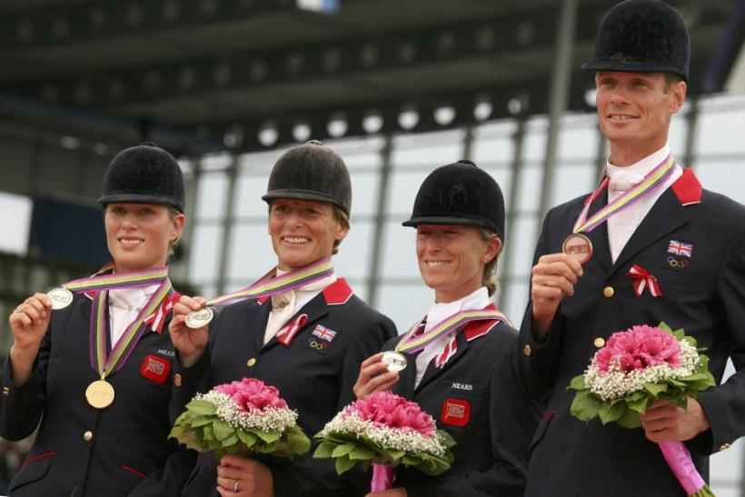 Britain's Eventing team (L-R) Zara Phillips, Mary King , Daisy Dick and William Fox Pix stand on the podium showing their Eventing Silver medals at the World Equestrian Games in Aachen
