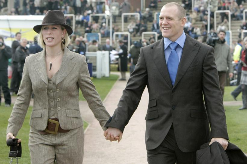Britain's royal and equestrian rider Zara Phillips (L) arrives with her boyfriend, Rugby Union player Mike Tindall, on the third day of the Cheltenham Festival horse racing in Gloucestershire, western England