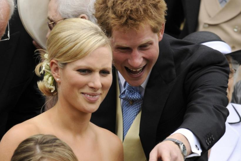 Britain's Zara Phillips (2L) and Prince Harry stand on the steps of St George's Chapel after the marriage between Peter Phillips and Autumn Kelly, in Windsor, southern England