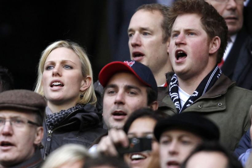 Prince Harry and Zara Phillips sing the national anthem as they stand in the crowd before a Six Nations rugby union match between England and France at Twickenham Stadium in west London