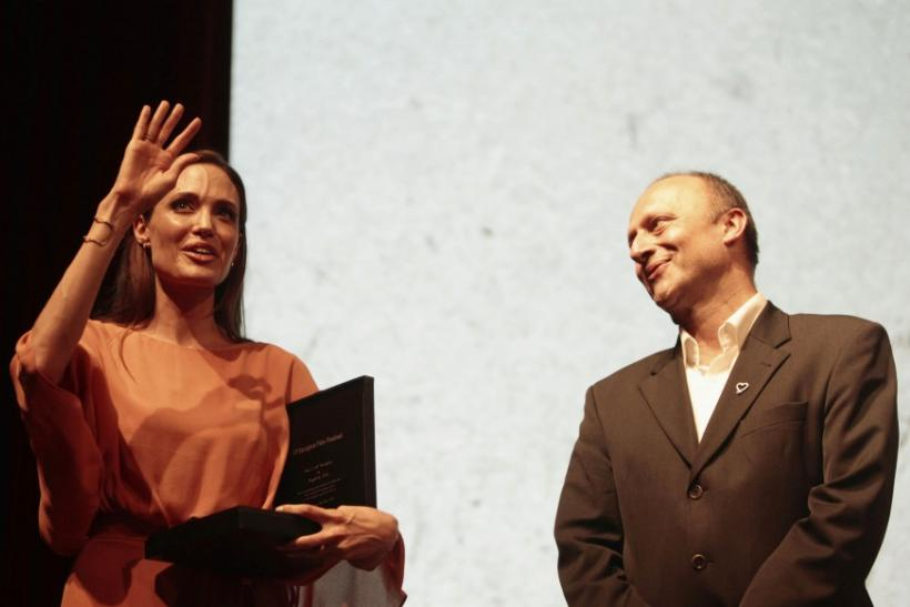 Angelina Jolie receives the Heart of Sarajevo honorary award from the director of the festival Mirsad Purivatra on the final night of the 17th Sarajevo Film Festival