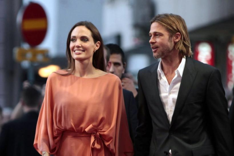 Angelina Jolie (L) and Brad Pitt arrive on the red carpet on the final night of the 17th Sarajevo Film Festival