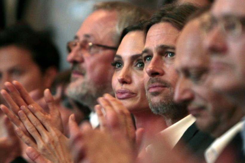 Angelina Jolie and Brad Pitt clap their hands on the final night of the 17th Sarajevo film festival
