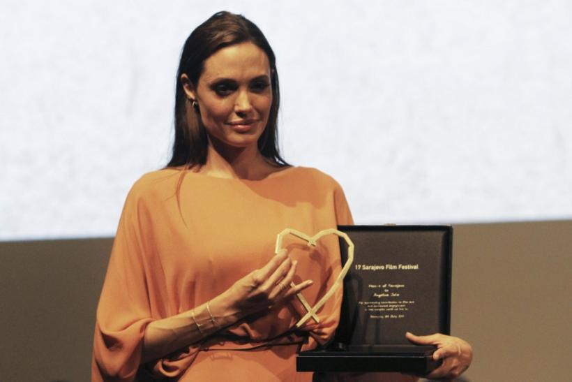 Angelina Jolie poses with the Heart of Sarajevo award which she received during the 17th Sarajevo film festival in Sarajevo